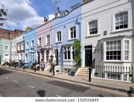 London street of old terraced houses without parked cars. - stock photo
