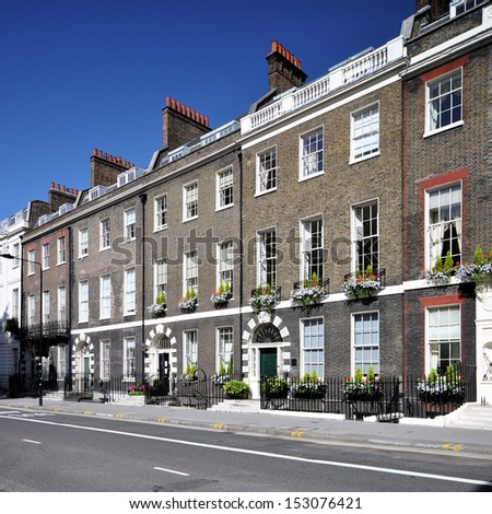 London street of preserved 18th century Georgian houses, without parked cars. - stock photo