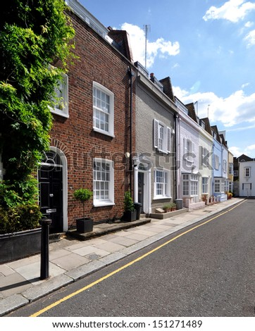 London street of small terraced houses, without parked cars.