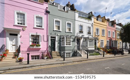 London street of terraced houses, without parked cars. - stock photo