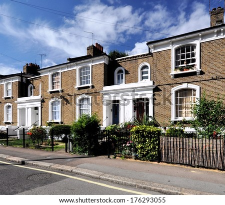 London street of 19th century Victorian period terraced houses, without parked cars.