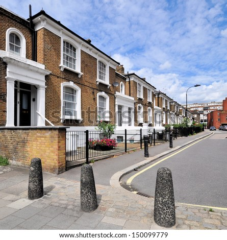 London street of typical small 19th century Victorian houses without parked cars - stock photo