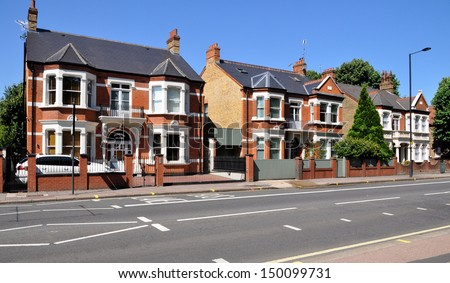 London street of typical Victorian terraced houses, without traffic. - stock photo