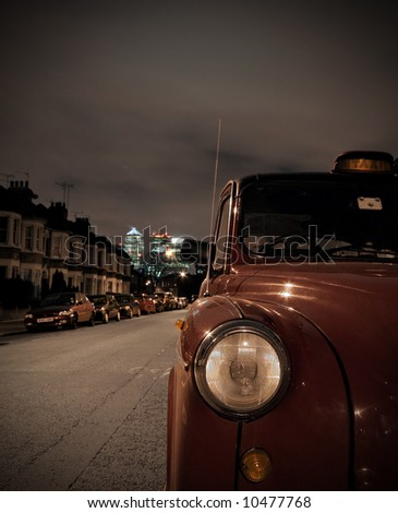London taxi parked on residential street - stock photo