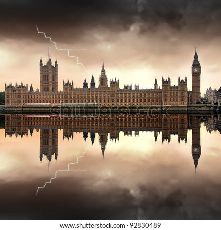 London - The Houses of Parliament with Big Ben dark clouds and a lightning - stock photo