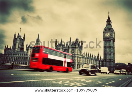 London, the UK. Red bus in motion and Big Ben, the Palace of Westminster. The icons of England in vintage, retro style - stock photo