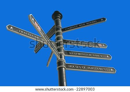 London Tourist Signpost Against Blue Sky - stock photo