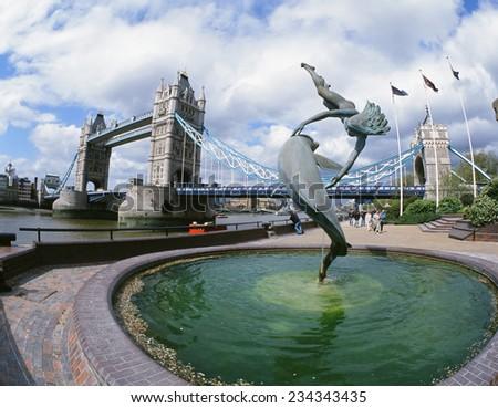 London - Tower Bridge and Dolphin Fountain, England - stock photo