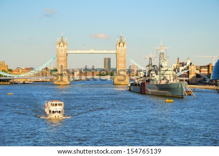 London Tower Bridge and river Thames in the evening light - stock photo