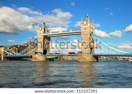 London Tower Bridge in evening light with white clouds - stock photo