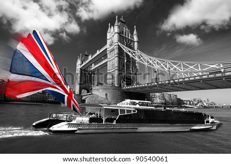 London Tower Bridge with colorful flag of England on city cruise - stock photo