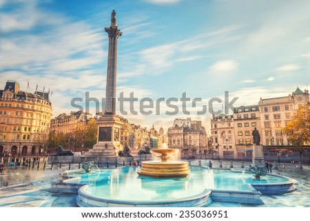 LONDON, TRAFALGAR SQUARE, NOV 18, 2014. Trafalgar Square is a public space and tourist attraction in central London. effect long exposure - stock photo