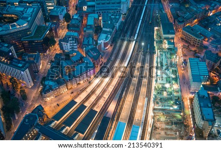 London. Train station and Tower Bridge night lights, aerial view. - stock photo