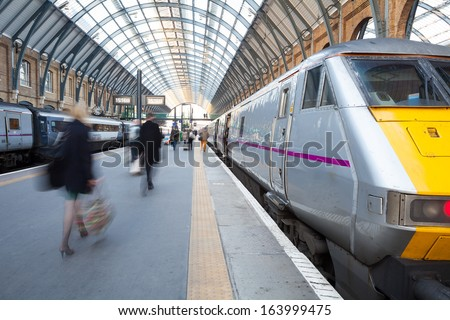London Train station Blur people movement in rush hour, King Cross station  - stock photo