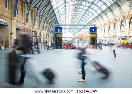 London Train Tube station Blur people movement in rush hour  - stock photo
