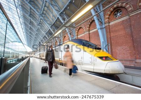 London Train Tube station Blur people movement King cross St. Pancras - stock photo