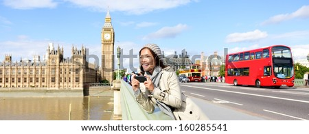London travel banner with woman tourist, Big Ben and red double decker bus. Girl taking photo on Westminster Bridge with smartphone camera over River Thames, London, England, Great Britain, UK. - stock photo