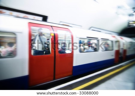 London tube train speeding through station, images cross processed. - stock photo