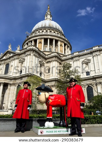 LONDON, UK - APR 18, 2015: Shaun the sheep sculpture in front of St Paul cathedral. The sculptures are placed in London's iconic locations, to raise funds for Wallace & Gromitâ??s Childrenâ??s Charity. - stock photo