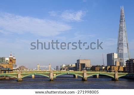 LONDON, UK - APRIL 2015: A beautiful view taking in the sights of the Shard, Southwark Cathedral, Southwark Bridge, tower Bridge and Cannon Street station in London on 20th April 2015. - stock photo