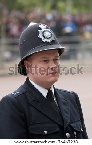 LONDON, UK - APRIL 29: A policeman at Prince William and Kate Middleton wedding, April 29, 2011 in London, United Kingdom - stock photo