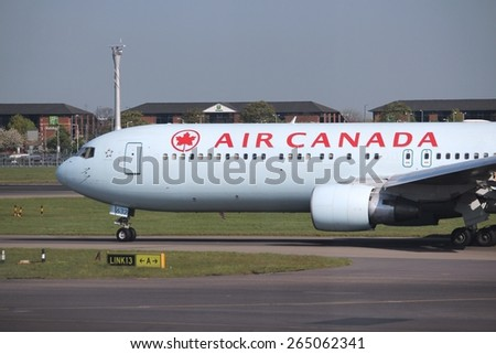 LONDON, UK - APRIL 16, 2014: Air Canada Boeing 767 after landing at London Heathrow airport. Air Canada is the largest airline of Canada with 35.8 million passengers carried in 2013. - stock photo