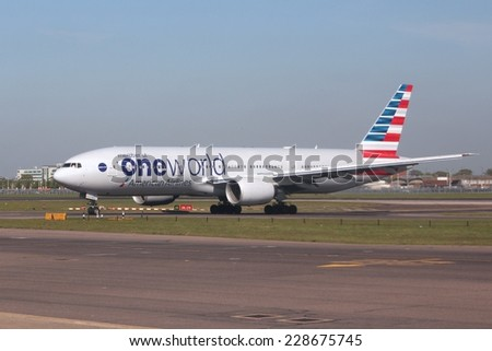 LONDON, UK - APRIL 16, 2014: American Airlines Boeing 777 in Oneworld alliance livery after landing at London Heathrow airport. Oneworld carries more than 500 million passengers annually. - stock photo