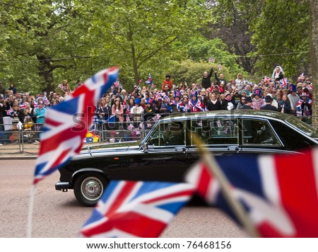 LONDON, UK - APRIL 29: An old Jaguar on the Mall at Prince William and Kate Middleton wedding, April 29, 2011 in London, United Kingdom - stock photo