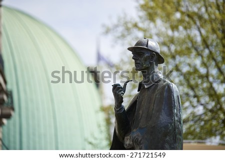LONDON, UK - APRIL 22: Bronze statue of Sherlock Holmes. April 22, 2015 in London. The statue, situated in front of Baker Street station, was commissioned by the Sherlock Holmes Society in 1999. - stock photo