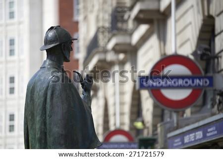 LONDON, UK - APRIL 22: Bronze statue of Sherlock Holmes in front of Baker Street station. April 22, 2015 in London. The statue was commissioned by the Sherlock Holmes Society in 1999. - stock photo