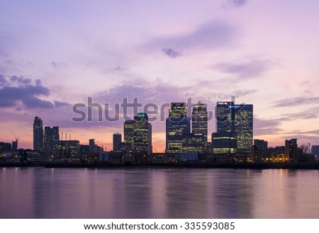 LONDON, UK - APRIL 07, 2015: Canary Wharf skyline at sunset. Canary Wharf is a major business district located in Tower Hamlets.