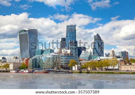 LONDON, UK - APRIL 30, 2015: City of London business and financial aria view from the River Thames embankment  - stock photo