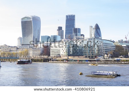 LONDON, UK - APRIL 20, 2016: City of London, one of the leading centres of global finance, at afternoon. View includes the Gherkin, Leadenhall, Stock Exchange Tower Lloyd`s of London and Walkie Talkie - stock photo