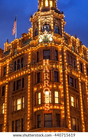 LONDON, UK - APRIL 18 2016: Clouds on Harrods gallery at dusk - stock photo