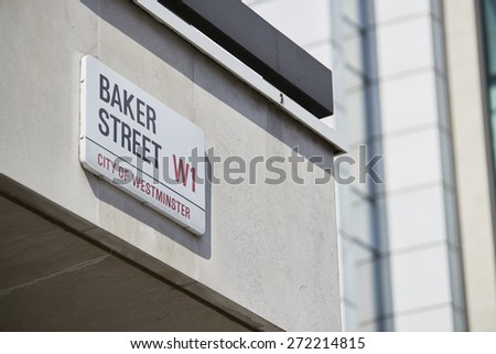 LONDON, UK - APRIL 22: Detail of Baker Street sign on empty white building wall. Lots of copy space. April 22, 2015 in London. The street was brought to fame by Sherlock Holmes's adventures. - stock photo