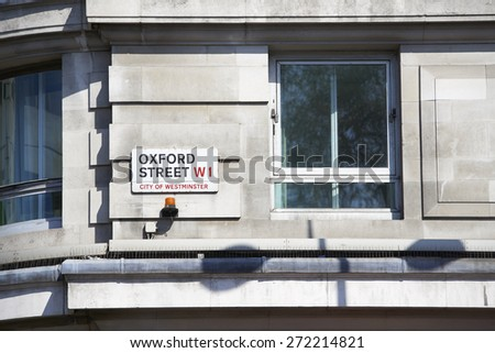 LONDON, UK - APRIL 22: Detail of Oxford Street sign next to an empty window. April 22, 2015 in London. Oxford Street is the main commercial street in the city. - stock photo