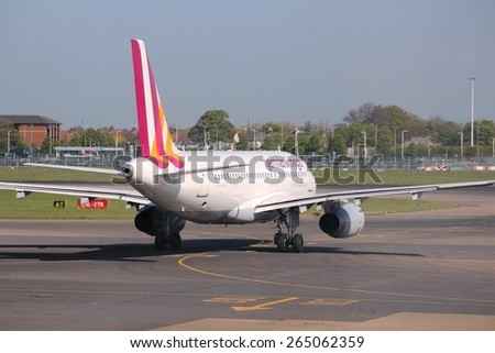 LONDON, UK - APRIL 16, 2014: Germanwings Airbus A319 at London Heathrow airport. Germanwings is a low cost airline owned by Lufthansa. It has fleet of 80 aircraft (2014). - stock photo