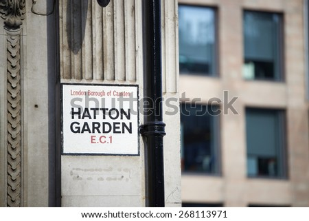 LONDON, UK - APRIL 07: Hatton Garden street sign. April 07, 2015 in London. The famous street is also known as diamond district due to its sheer number of jewelry shops. - stock photo