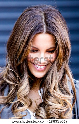 LONDON, UK - APRIL 22:Kate Beckinsale is spotted filming scenes from a new tv  drama in London on the April, 2014 in London, UK - stock photo