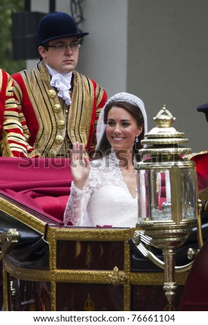 LONDON, UK - APRIL 29:  Kate Middleton ride in a carriage on her way to Buckingham Palace after her wedding on the April 29, 2011 in London, UK - stock photo