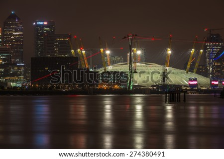 LONDON, UK - APRIL, 25 2015: Millennium Dome at night, view across river Thames. It was built to house an exhibition celebrating the beginning of the third millennium. It's now a key feature of The O2 - stock photo