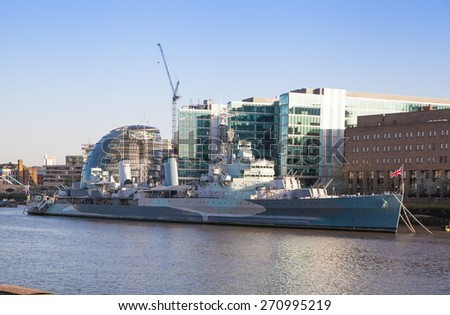 LONDON, UK - APRIL15, 2015: Old battle ship. South bank of river Thames walk. - stock photo
