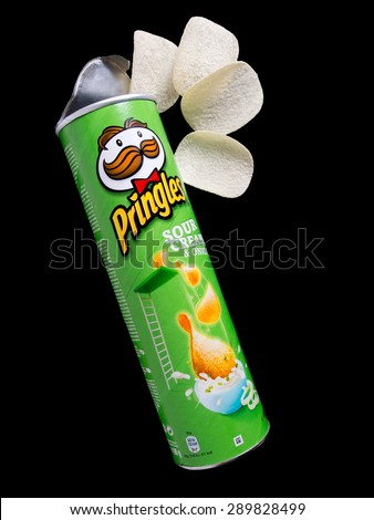 "LONDON, UK â?? APRIL 9, 2015: Originally marketed as ""Pringles Newfangled Potato Chips"", Pringles are sold in more than 140 countries. Owned by Kellogg, they enjoy an unusual VAT position in the UK. - stock photo"