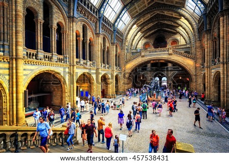 LONDON, UK - APRIL 28, 2016: People in the main hall at Londons Natural History Museum. With over 70 million specimens on display it is one of Londons most popular visitor attractions. - stock photo