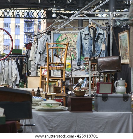 LONDON, UK - APRIL 22, 2016: People shop at Old Spitalfields Market in London. A market existed here for at least 350 years. - stock photo
