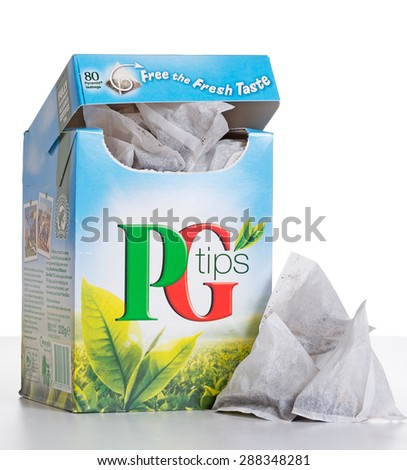 LONDON, UK APRIL 9, 2015: PG Tips has been a favourite brand of tea in the United Kingdom since the 1930's, recognisable by innovative triangular tea bags. It is also Rainforest Alliance certified. - stock photo