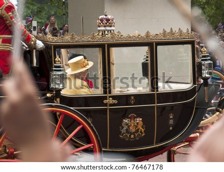 LONDON, UK - APRIL 29: Queen Elizabeth in her coach at Prince William and Kate Middleton wedding, April 29, 2011 in London, United Kingdom - stock photo