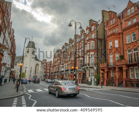 LONDON, UK - April 13, 2016: Red bricks houses in London, english architecture in the posh neighbourhood of Sloane Square - stock photo