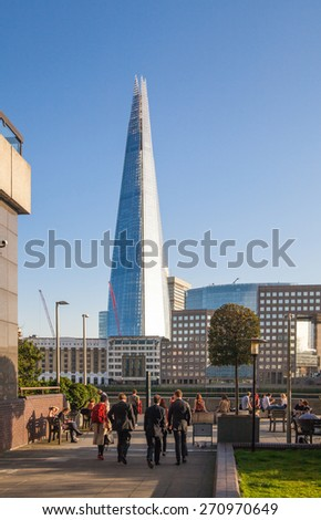 LONDON, UK - APRIL15, 2015: Shard of glass in sunset. Panoramic view of south bank river Thames walk. - stock photo