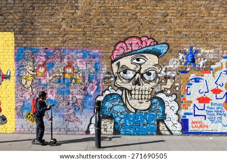 LONDON, UK - APRIL 21, 2015: Street art in Hanbury Street Shoreditch in the Borough of Tower Hamlets, an area renown for its paintings and posters in east London, UK. - stock photo